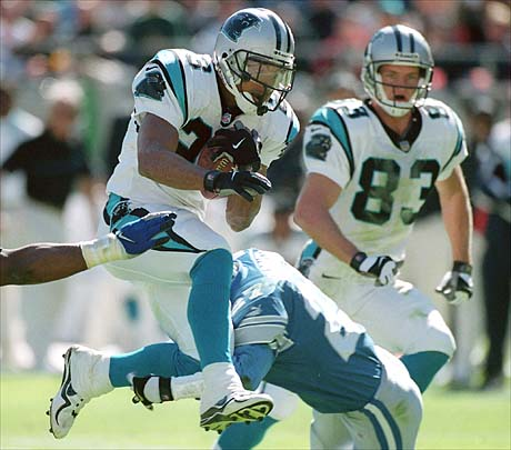 10/24/99 Carolina Panthers (23) Anthony Johnson avoids the Detroit Lions defense Sunday afternoon as he leaps into the air on a run upfield.  The Panthers were defeated by the Lions 24-9.