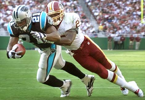 Carolina Pathers' Tshimanga Biakabutuka (21) holds on to the ball as he scores the team's second touchdown as Washington Redskins' Sam Shade (29) tries  stop him during the first quarter Sunday, Oct. 3, 1999 at Redskins Park in Landover Md. (AP Photo/Pablo Martinez Monsivais)