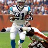 Carolina Panthers running back Tshimanga Biakabutuka breaks the tackle of Cleveland Browns linebacker Jamir Miller to take a screen pass 21 yards to the one yard line in the second quarter Sunday, Nov. 21, 1999, in Cleveland. (AP Photo/Mark Duncan)