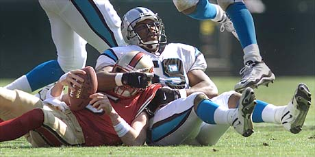 10/17/99: SanFrancisco, CA:  Carolina Panther's  Ernest Jones enjoys the sack job done on  SanFrancisco's Quarterback Jeff Garcia during the first half of actionThe  Carolina Panthers went on to Win 31-29 Sunday afternoon.
