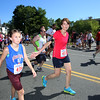 Annual 2-mile John Carson Road Race before the Chelmsford 4th of July parade. Sydney Michaud, 12, left, and Renee Michaud (#433), both of North Chelmsford. (SUN/Julia Malakie)