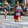 Annual 2-mile John Carson Road Race before the Chelmsford 4th of July parade. Men's division winner Louis Serafini, 25, of Brighton (#1899), and 2nd place finisher Brian Harvey of Cambridge. (SUN/Julia Malakie)