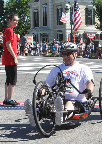 Annual 2-mile John Carson Road Race before the Chelmsford 4th of July parade. Wheelchair finisher and winner Erick Larson, 54, of Chelmsford. (SUN/Julia Malakie)