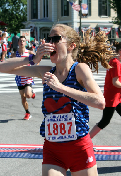 Annual 2-mile John Carson Road Race before the Chelmsford 4th of July parade. Women's winner Rosa Moriello, 24, of Brighton, reacts to her time. [She said she got another $1,000 for setting a new course record.] (SUN/Julia Malakie)