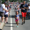 Annual 2-mile John Carson Road Race before the Chelmsford 4th of July parade. Matthew Weagle of Auburn (#422) and Camryn Weagle, 6 (#424). (SUN/Julia Malakie)