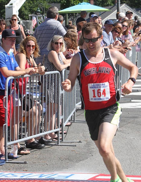 Annual 2-mile John Carson Road Race before the Chelmsford 4th of July parade. Men's division 3rd place Neal Darmody of Groton. (SUN/Julia Malakie)