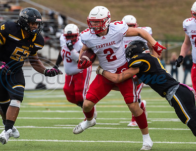 Carthage's Mason Courtney (2) evades a Crandall defenders Mason Daugherty (8) and Calob Davis(52) during playoff action Friday, Nov. 29, 2019, at Chirstus Trinity Mother Frances Rose Stadium in Tyler. (Cara Campbell/Tyler Morning Telegraph)