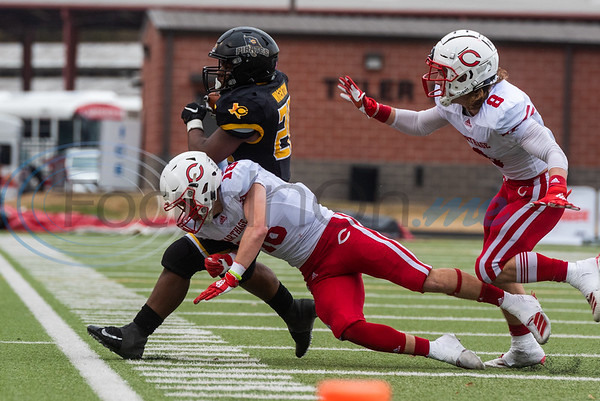 Carthage's Austin Morgan (16) attempts to take down Crandall's Damerian Wigenton (28) during playoff action Friday, Nov. 29, 2019, at Chirstus Trinity Mother Frances Rose Stadium in Tyler. (Cara Campbell/Tyler Morning Telegraph)
