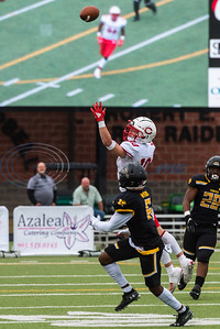 Carthage's Mason Bobo (10) attempts to intercept the ball in front of Crandall's Billy Myers during playoff action Friday, Nov. 29, 2019, at Chirstus Trinity Mother Frances Rose Stadium in Tyler. (Cara Campbell/Tyler Morning Telegraph)
