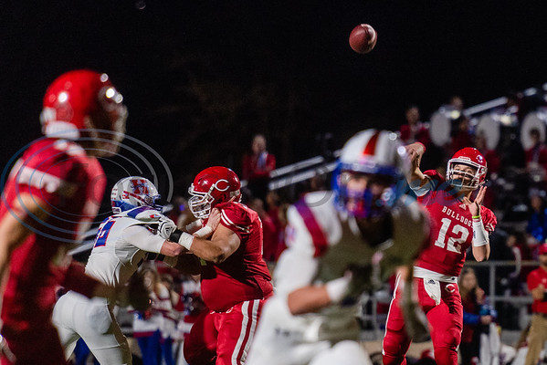 Carthage's Kai Horton (12) attempts a pass to teammate Kelvontay Dixon (3) during 4A Division I playoff action against Midlothian Friday, Dec. 6, 2019, at the Tomato Bowl in Jacksonville. (Cara Campbell/Tyler Morning Telegraph)