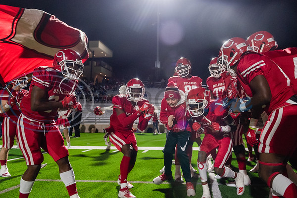 Carthage Bulldogs chant outside their tunnel before running onto the field prior to a 4A Division I playoff game against Midlothian Friday, Dec. 6, 2019, at the Tomato Bowl in Jacksonville. (Cara Campbell/Tyler Morning Telegraph)