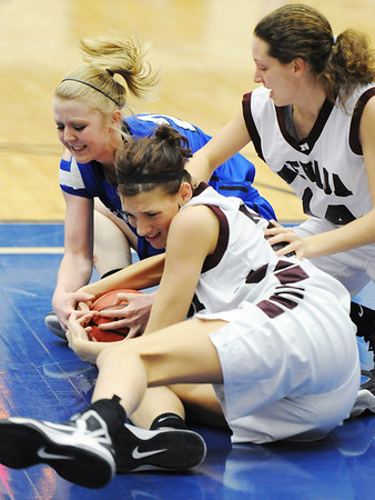 Globe/T. Rob Brown<br /> Carthage's Amy Keller competes for a loose ball with Nevada's Rilie Good (foreground) and Ashley Shumaker (right) during the District 12 Class 4 Basketball Tournament Thursday evening, Feb. 28, 2013, at Carthage High School's gymnasium.