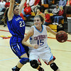 Globe/T. Rob Brown<br /> Webb City's Mikaela Burgess drives the ball around Carthage's Leigh Ann Craig as Burgess heads toward the basket during Monday night's game, Feb. 11, 2013, at Webb City's gymnasium.