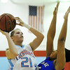 Globe/T. Rob Brown<br /> Webb City's Desirea Buerge goes up for two over Carthage's Maya Williams during Monday night's game, Feb. 11, 2013, at Webb City's gymnasium.