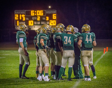 Casa Grande offense confers with the coach during a time out in the second quarter against Miramonte.