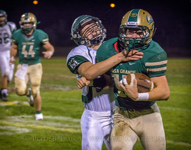 Casa Grande #13 is forced down by a Miramonte defender after running for a first down in the second quarter.