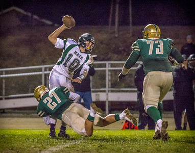 Casa Grande #27 sacks Miramonte quarterback #10 for a loss late in the second quarter.