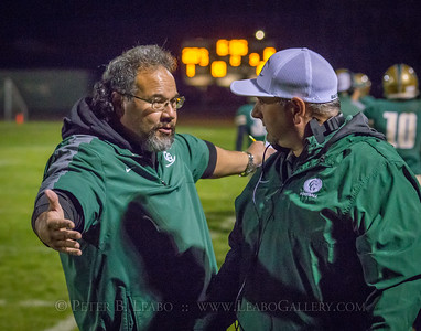 Casa Grande coaches confer on the sideline in the second quarter against Miramonte.
