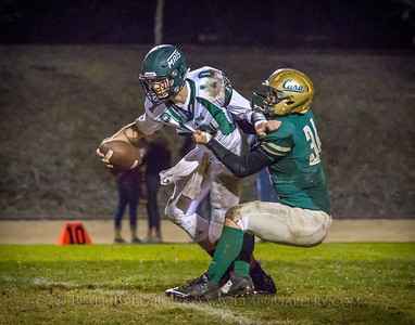 Casa Grande #34 sacks Miramonte quarterback #10 deep in his own territory in the third quarter.