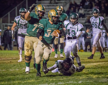Casa Grande #34 breaks loose from Miramonte #26 for a first down in the first quarter.