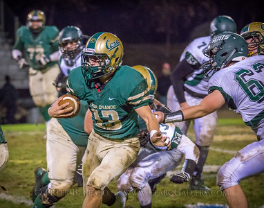 Casa Grande #13 breaks away from Miramonte defenders #13 and #63 for a first down in the second quarter.