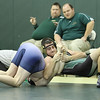 Blessed Trinity High School junior Evan Strawn, right, pinned his St. Pius X opponent at the 5:46 mark of their 6:00 match. Blessed Trinity defeated Marist School and St. Pius X High School to retain the Catholic Duals Championship.