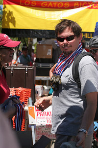 Martin Wensley with medals for kids