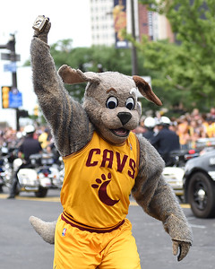 KRISTIN BAUER | GAZETTE Cleveland Cavaliers mascot Moondog carries his championship ring during the parade celebrating the Cleveland Cavaliers' NBA Championship win.