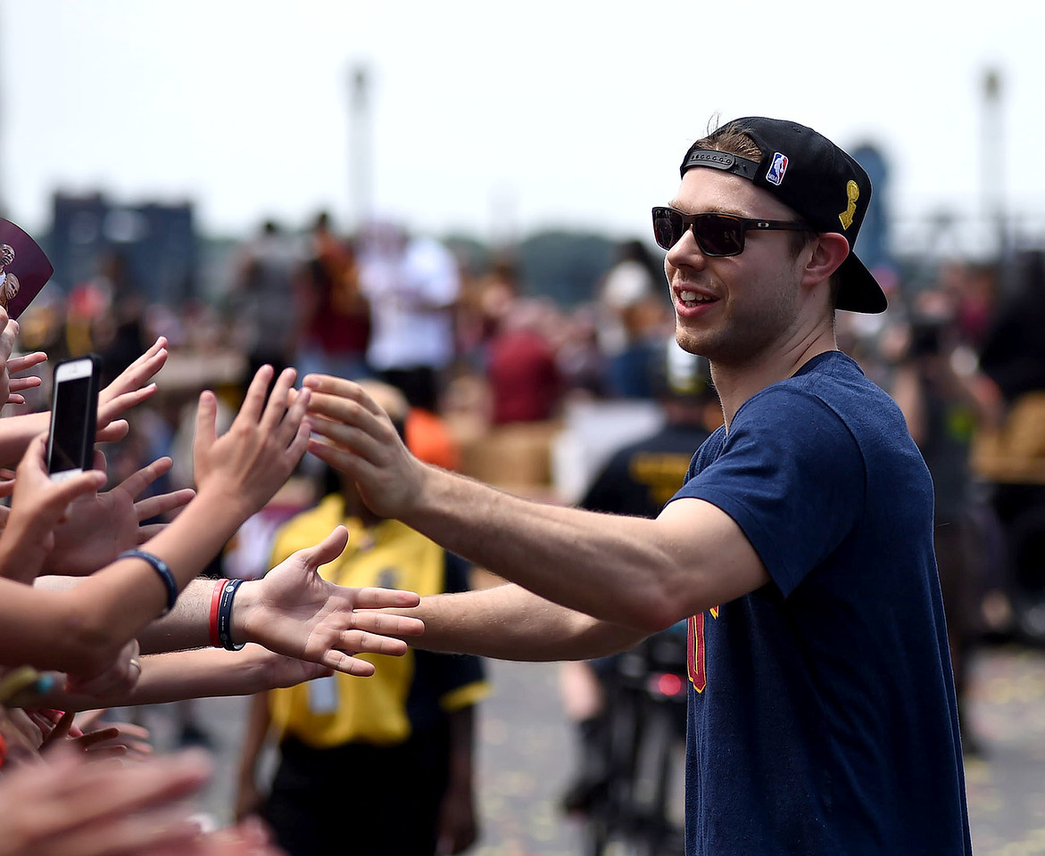 KRISTIN BAUER | GAZETTE Cleveland Cavaliers' Matthew Dellavedova high-fives fans during the parade dedicated to celebrating the Cavs' championship win.