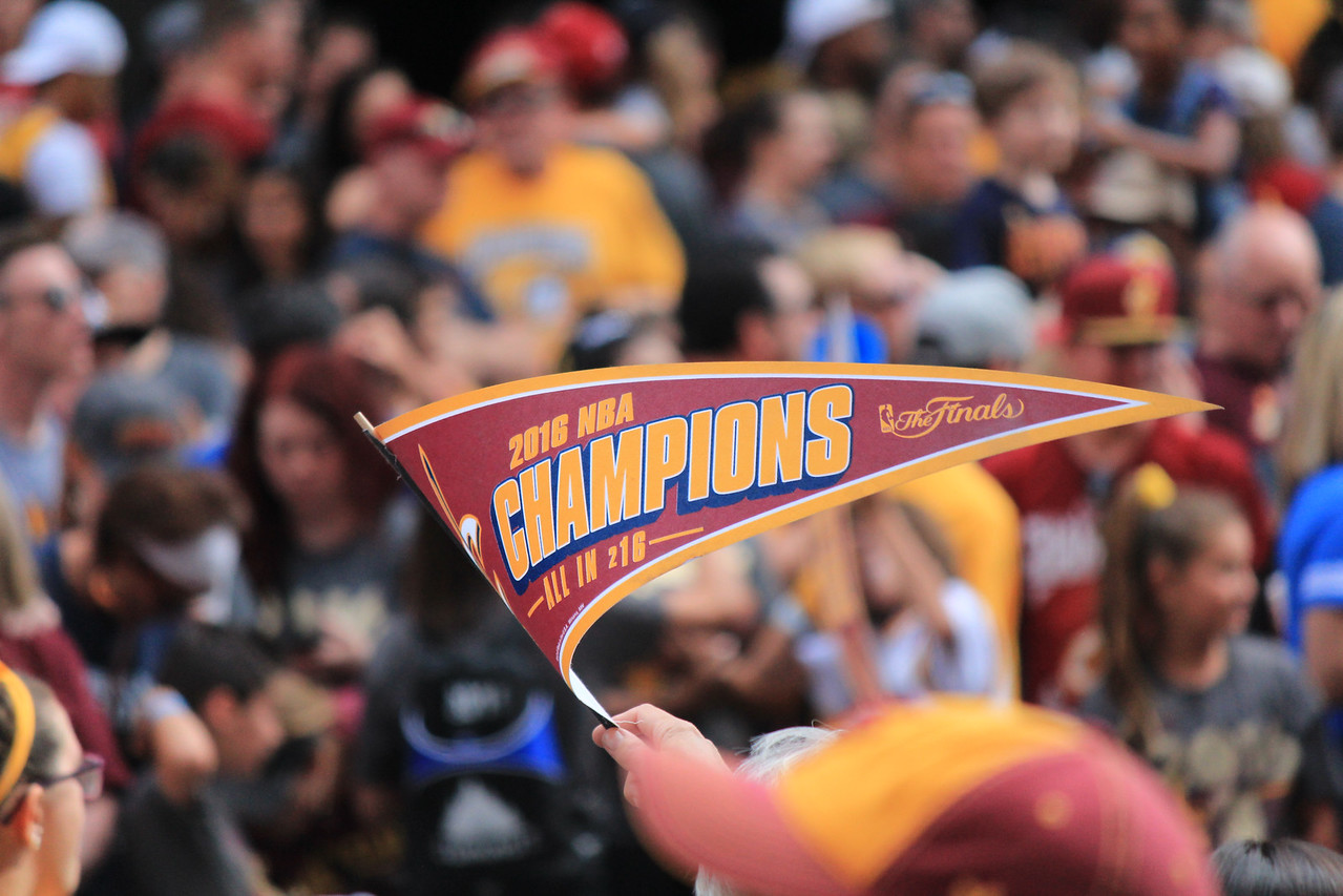 HALEE HEIRONIMUS / GAZETTE A championship pennant held by a parade-goer says it all on Wednesday during the downtown Cleveland celebration.