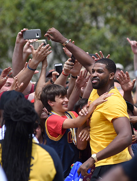 KRISTIN BAUER | GAZETTE Cleveland Cavaliers' Tristan Thompson visits with fans while riding in the parade celebrating the Cavs championship title.