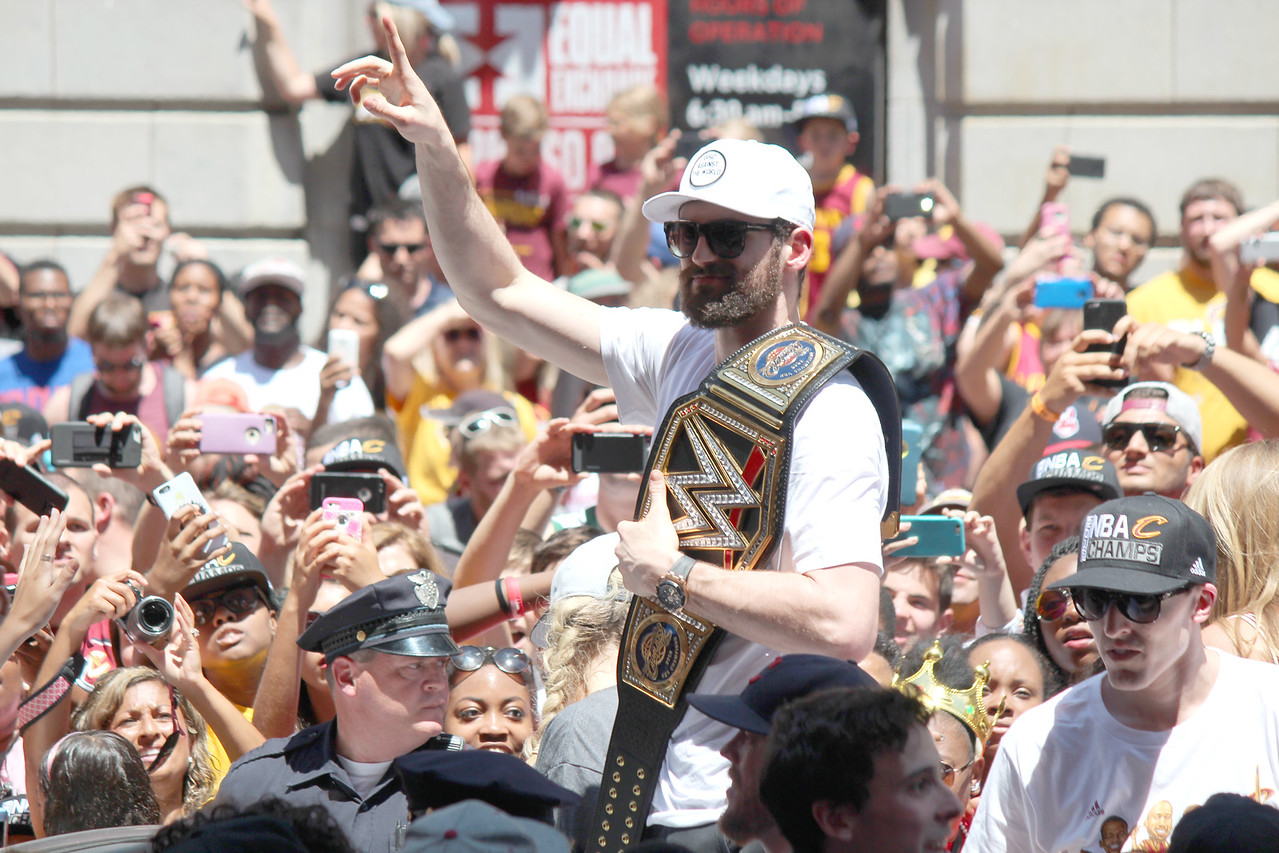 HALEE HEIRONIMUS / GAZETTE Cavaliers forward Kevin Love brought a wrestling championship belt to the victory parade.