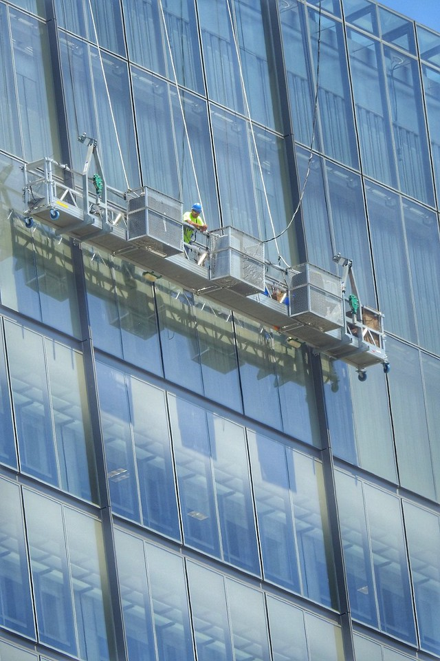 Window washers get a great vantage point for the Cavs' championship parade. BRUCE BISHOP/GAZETTE