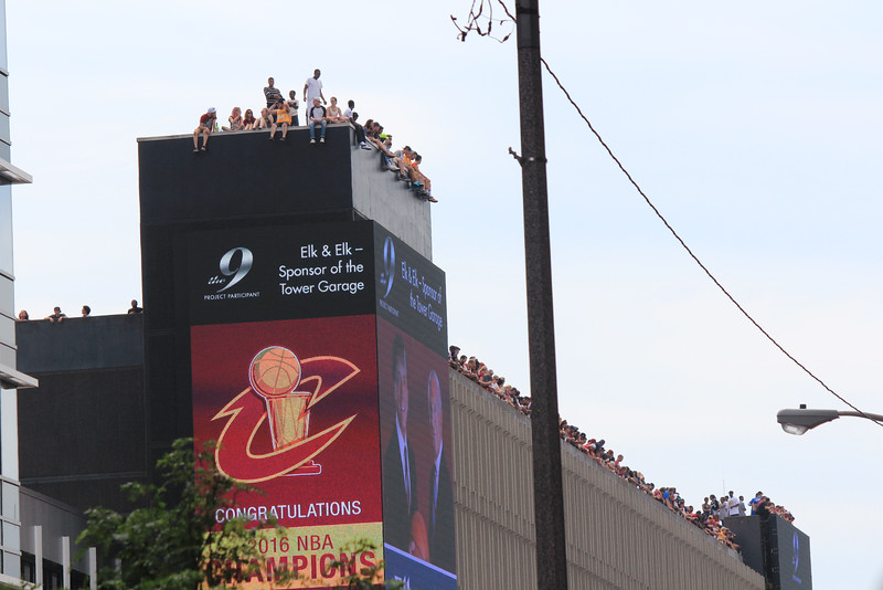 HALEE HEIRONIMUS / GAZETTE The roof of a building along the parade route was a popular place to help the Cleveland Cavaliers and their fans celebrate the 2016 NBA Finals victory on Wednesday morning.