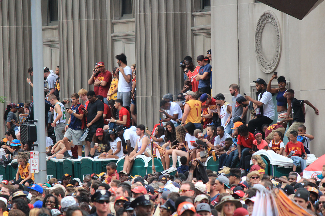 HALEE HEIRONIMUS / GAZETTE Younger children found a place to remain stationary for a time among thousands of fans on Wednesday in downtown Cleveland during the Cavaliers' 2016 NBA Finals championship parade.