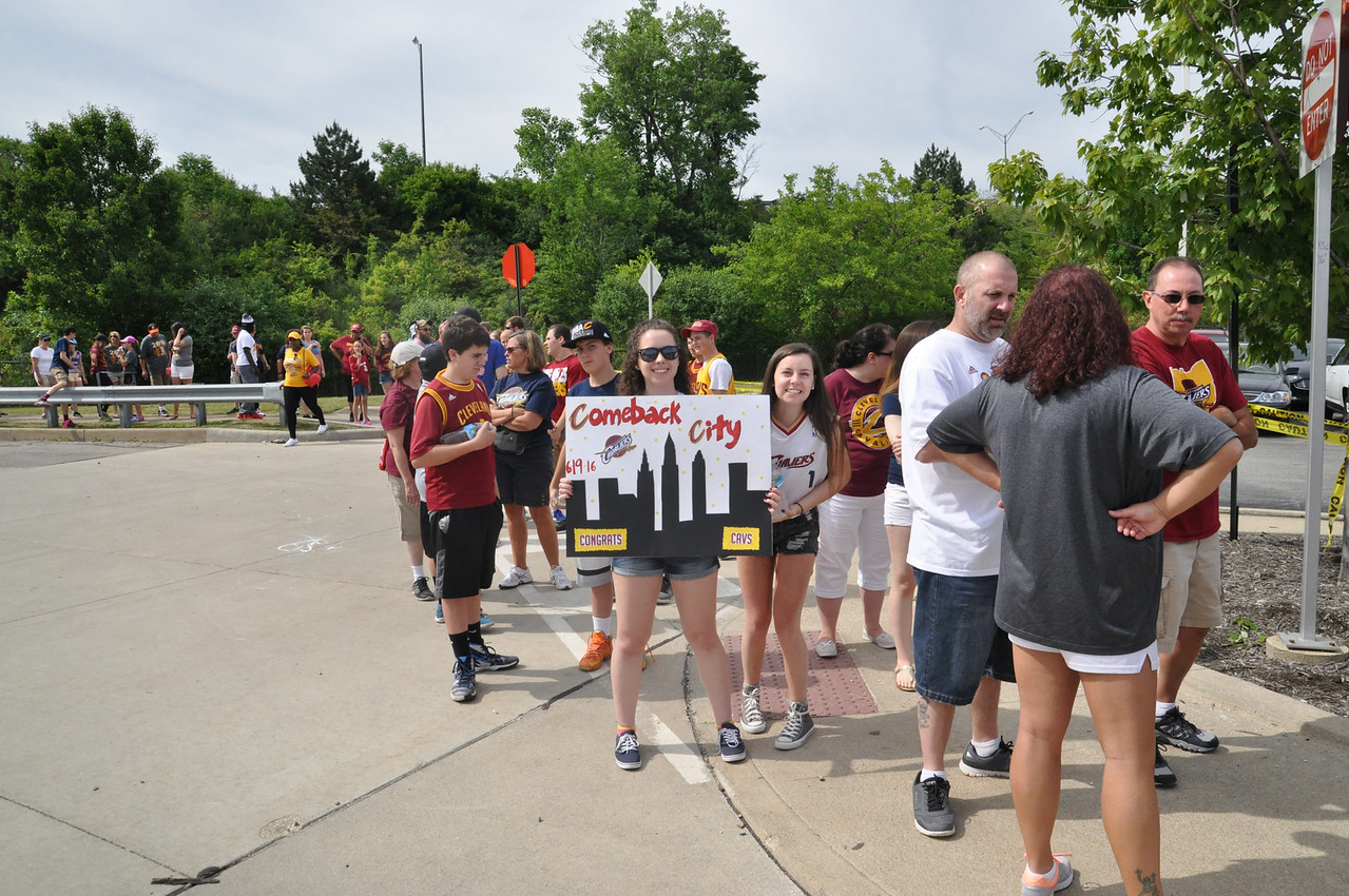 ASHLEY FOX / GAZETTE Carolyn Lloyd, left, and Annie Lloyd, right, from North Royalton stand in line at the RTA at W. 150th. The twins stood in line for a couple of hours with their sister, brother, family friend and mother. The group agreed that Kyrie Irving is their favorite player.