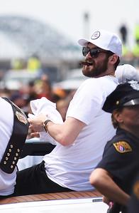 KRISTIN BAUER |GAZETTE Cleveland Cavaliers' Kevin Love throws T-shirts to fans while riding in the parade celebrating the Cav's championship title.