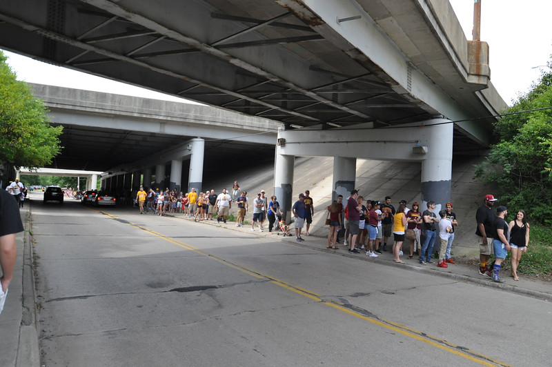 ASHLEY FOX / GAZETTE Cleveland Cavaliers fans stood for hours on West 150th Street in Cleveland on Wednesday, waiting for public transportation to take them downtown to a parade and rally. The line stretched to Puritas Avenue, with people making their own parking lots.