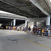 ASHLEY FOX / GAZETTE<br /> Cleveland Cavaliers fans stood for hours on West 150th Street in Cleveland on Wednesday, waiting for public transportation to take them downtown to a parade and rally. The line stretched to Puritas Avenue, with people making their own parking lots.