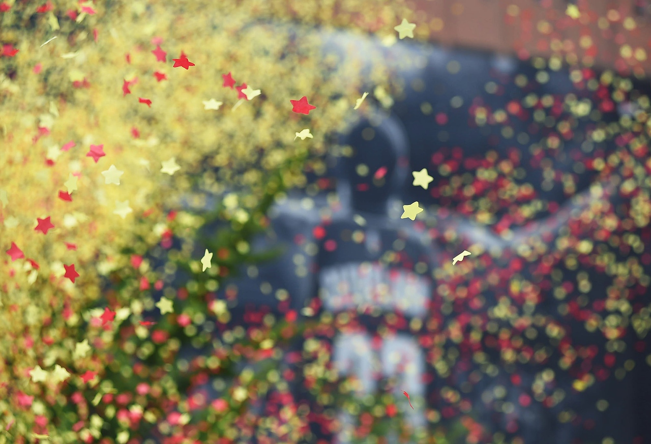 KRISTIN BAUER | GAZETTE Confetti flew as fans cheered during the parade celebrating the Cleveland Cavaliers on their 2016 NBA Championship title.