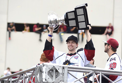 KRISTIN BAUER | GAZETTE Monsters' right wing Oliver Bjorkstrand holds up the Calder Cup during a parade dedicated to celebrating Cleveland's recent achievements in sports.