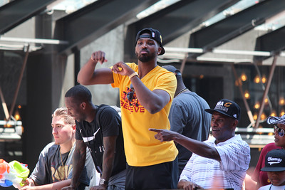 HALEE HEIRONIMUS / GAZETTE Cavs forward-center Tristan Thompson helped the team celebrate its 2016 NBA Finals victory during a parade in downtown Cleveland on Wednesday. Thompson will appear today at 6 p.m. at Macy's at Summit Mall in Fairlawn to sign 200 autographs on 2016 merchandise purchased at $25 or more.