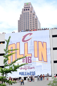 KRISTIN BAUER | GAZETTE Fans stand at every vantage point of the parking deck, even climbing out on the narrow ledge to watch the Cleveland Cavaliers parade down the streets of Cleveland in celebration of the NBA Championship title.