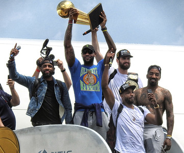 From left, Kyrie Irving, Lebron James, Kevin Love, Tristan Thompson, JR Smith come off the plane with the Larry O'Brien Trophy. BRUCE BISHOP/CHRONICLE