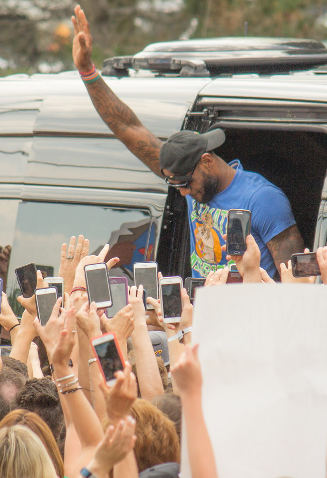 ALEC SMITH / GAZETTE Cavaliers star LeBron James emerged from a black van for about 90 seconds Monday afternoon on Crystal Lake Road in Bath Township to acknowledge a crowd estimated at 2,000 who gathered nearby his home to congratulate him and share in the moment of winning the 2016 National Basketball Association championship.