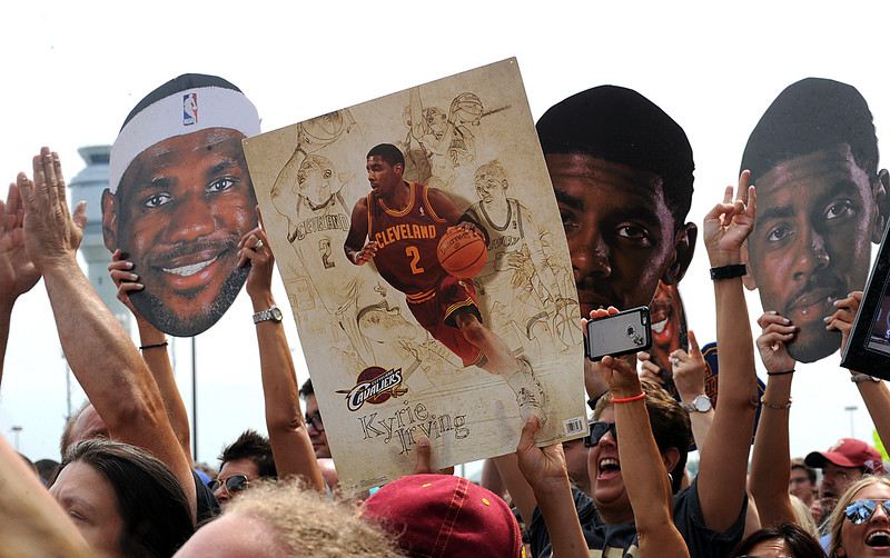 Cavaliers fans cheer at the arrival of the team at Cleveland Hopkins Airport after winning the NBA championship on Mon. June 20.  STEVE MANHEIM/CHRONICLE