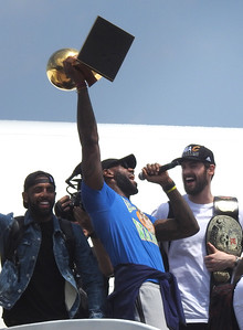 Kyrie Irving, Lebron James, and Kevin Love celebrate as they come off the plane after arriving in Cleveland. BRUCE BISHOP/CHRONICLE
