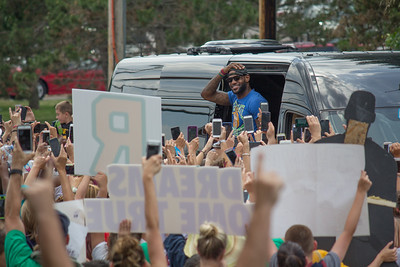 ALEC SMITH / GAZETTE After returning by plane to the I-X Center in Brook Park, LeBron James came back to his Bath Township home early Monday afternoon to greet a crowd of well-wishers estimated at 2,000.