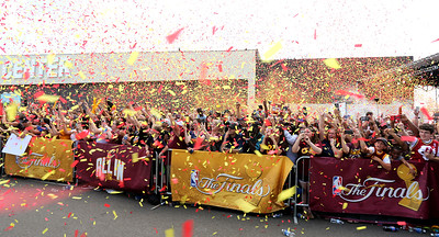 Confetti flies as the Cavs plane pulls up outside the crowds who came out to the IX Center to see the world champions return. BRUCE BISHOP/CHRONICLE