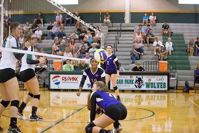 Heaven Burton and Sheridan Hartman look to save the ball against Cedar Park on Tuesday, Aug 25, 2015 at Cedar Park High School. CHRISTINA SHAPIRO FOR ROUND ROCK LEADER